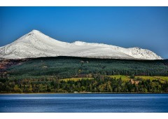 Brodick Castle and snowy Goat Fell